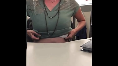 Sexy blonde having fun in the office