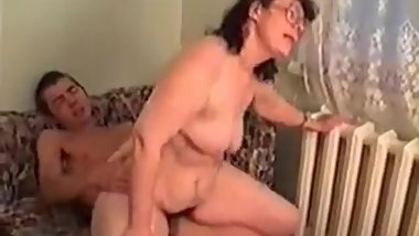 Mature Lady With Glasses has Fun With Younger Guy