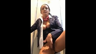 Perverted stewardess playing with her pussy